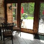  The sunroom and back patio offer a delightful view of Cooper&#39;s Woods and some local softball gam
