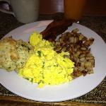  Most amazing scrambled eggs ever, scone, bacon and potatoes.