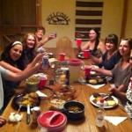 A tour group enjoys the Paria Guest Ranch Cowboy Steak dinner.