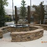 Gas fire pit and seating area near the pool.