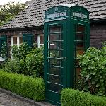 A green phone booth (decor), walking to Reception.