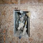  exposed wires in the bathroom from the non-working jacuzzi