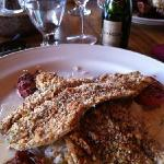 pecan crusted trout over rice pilaf and roasted tomatoes.