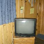  The ~24&quot; tv... notice windows in door that allow morning light to wake you up