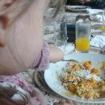  This is my baby shovelling in her curry and rice!!
