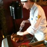 Sous-Chef carving the roast chicken