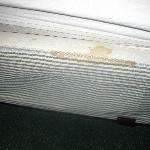 Nasty stained box spring of bed