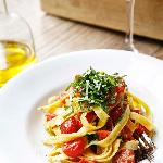 Homemade Tagliatelle with fresh tomatoes and basil