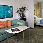 Spread out with additional seating area in every suite, including a sofa sleeper, large work des