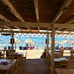 restaurant and beach front with chairs and umbrellas..
