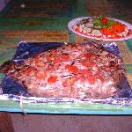 A red snapper grilled over the pit