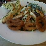 Chicken Caesar salad with onion rings as a side order