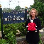 Miss Sadie, my authentic handmade Amish doll, in front of B&B.