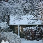 Cottage in the winter snow
