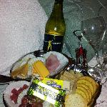 Chilled wine plus a cheese, cracker & fruit tray in our room at check-in