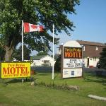Front of the motel - sign from road