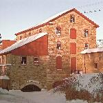 The mill in winter with a light dusting of snow.