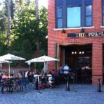 Outdoor seating and open doors of the Purple Pub