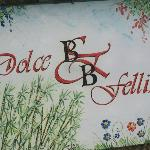 Sign on building of Dolce Felline