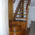 Stairs to upper bedroom, bath.