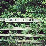 The charming sign of The Golf House