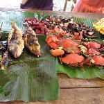 Food we bought at Subic market, grilled for us by our boatman