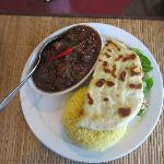 Beef vindaloo combination plate - curry, rice, nan bread & salad.
