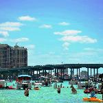 Relax and play in the waist deep, emerald green waters of Crab Island on SunVenture's Destin cru