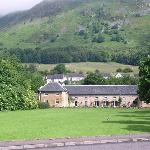 Harviestoun Country Hotel, Tillicoultry with Ochil Hills in background.