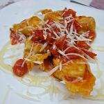  Potato Tortelloni with pecorino di fossa, caramelized tomatoes and honey