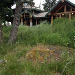 Beautiful log B&B surrounded by natural landscaping