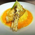 Grouper over cheesy grits topped with grilled white asparagus.