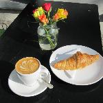 A flat white and organic croissant