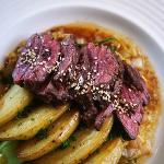 HANGAR STEAK with a kimchi and mustard seed pureé, and fried potato confit
