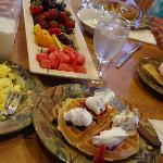 Breakfast starts with fresh fruit and the waffles have fruit too!
