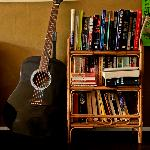 books, guitar at the living room