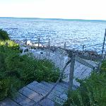 View of Whitefish Bay & private dock from motel unit grounds