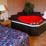  Surprising red heart-shaped jacuzzi in this room.