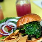 Grilled portabello with sundried tomato pesto & spinach on brioche bun