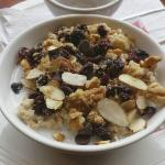 Oatmeal porridge with cranberries, raisins, sultanas, almond & walnut flakes,choc chips, brown s