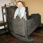 The baby bed/crib / rocker. Handmade and really cool-looking! Not the best for a crawler thoug