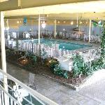 Huge indoor pool area, 2 levels with chairs and tables
