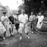 Groom and groomsmen playing golf being church.