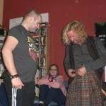 "Jon showing us how to fasten a kilt properly in the living room which he calls the ""art room"""