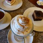  Cappuccino with cream, tea and cakes.