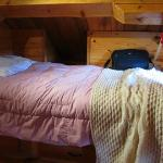 Captain style twin bed in dormitory loft, cubby also.