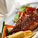 Enjoy Flame Tree Restaurant's Steak Friday every Friday