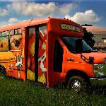 Our cozy customized tour bus will pick you up!