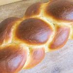 Every Friday we bake our fluffy challah, made with local honey & eggs