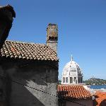  View out other room window: cathedral, sea, island